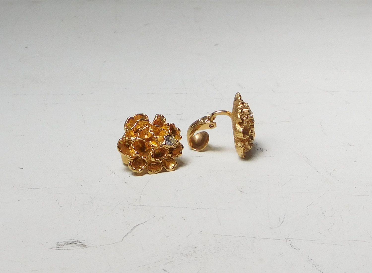 Gold Tone Rhinestone Clip On Earrings From Avon Vintage Costume Jewelry  Coral Flower Design