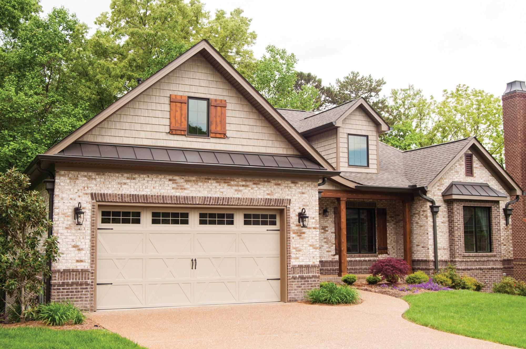 Carriage House Style Garage Door Brings Old World Charm Garage Door Design House Exterior House Designs Exterior