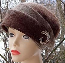 """""""MARY"""" …  Fashioned from a 1920's flapper hat, this wrap style cloche has relevance today – especially with the Downton Abbey craze.  It is light as a feather made from variegated and needlefelted alpaca.  Looks best when worn on a tilt."""