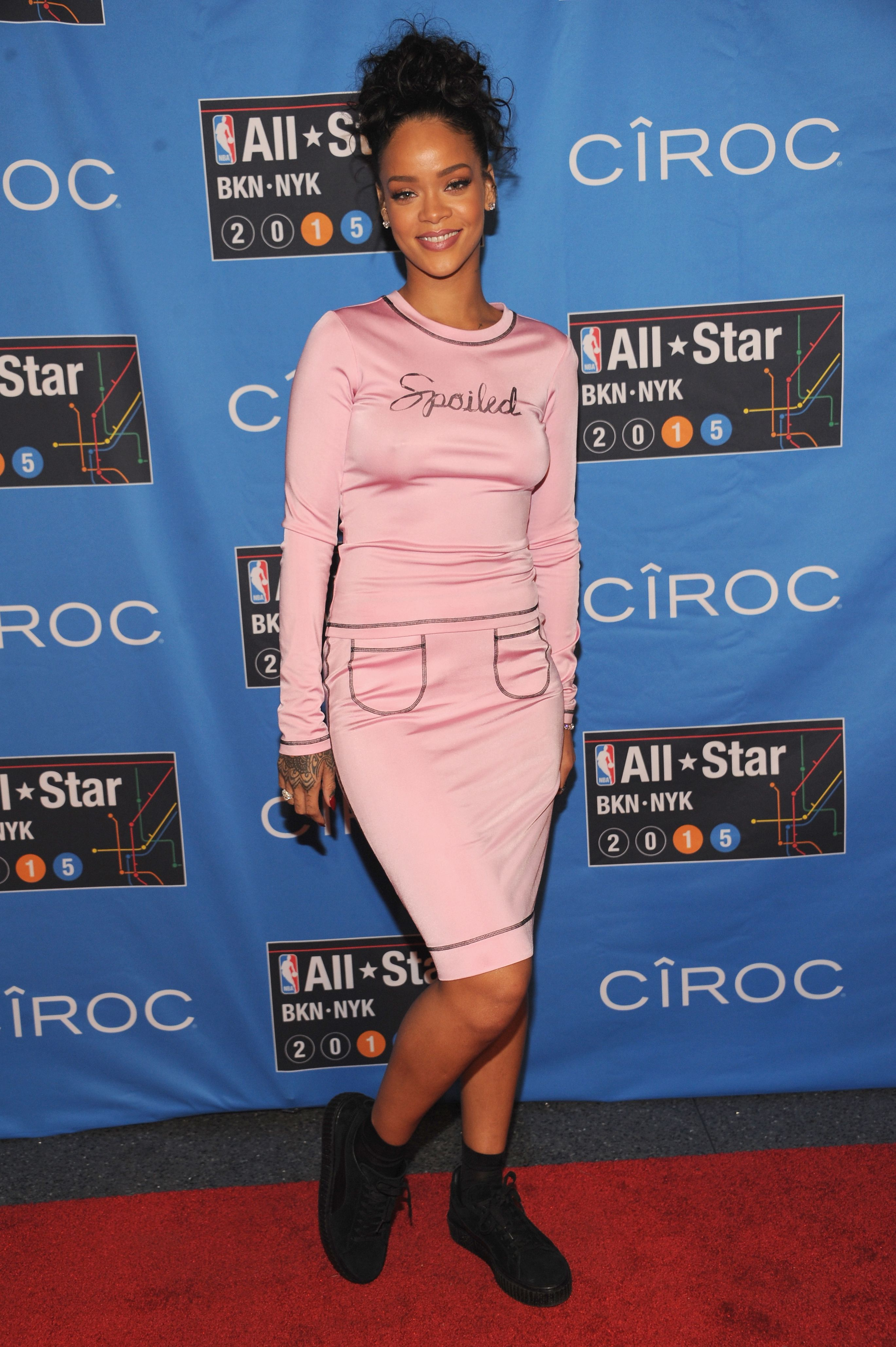 """Just two days after Adam Selman debuted this silky, long-sleeved pink dress that reads """"Spoiled,"""" on the runway, RiRi rocks it at an NBA All Star pre-party.   - MarieClaire.com"""