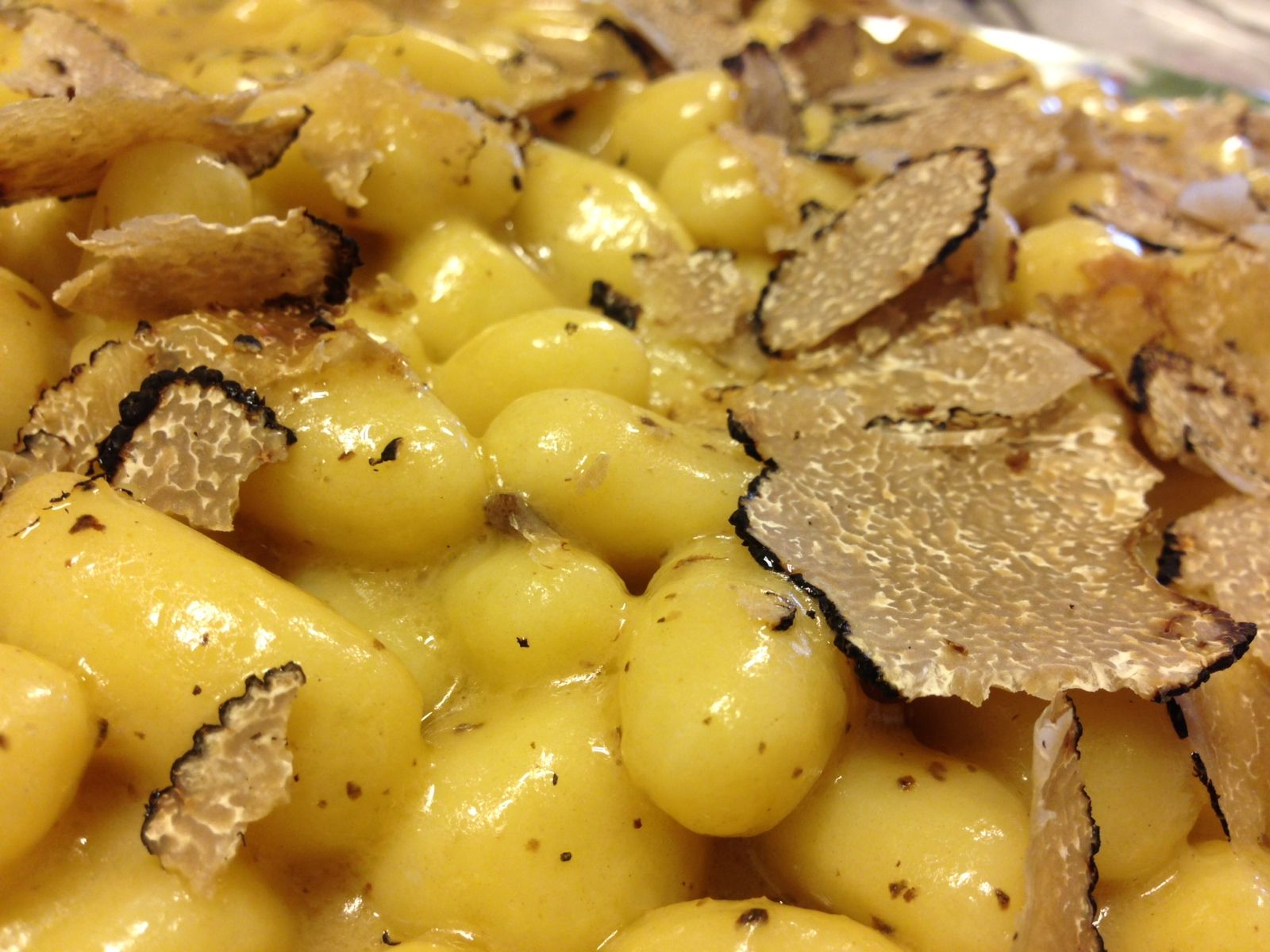 Potatoes gnocchi hand Made with truffle butter and shaved black truffle on top