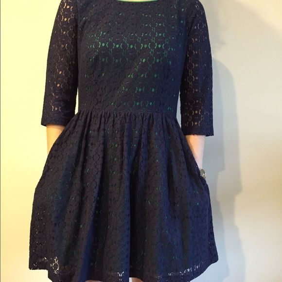 Barely worn Lilly Pulitzer dress Barely ever worn beautiful navy with green underlay Lilly dress. Perfect for winter into spring. Make it casual or formal! Great layering dress with an adorable key hole cut out on the upper back. Even has pockets!! Lilly Pulitzer Dresses Long Sleeve