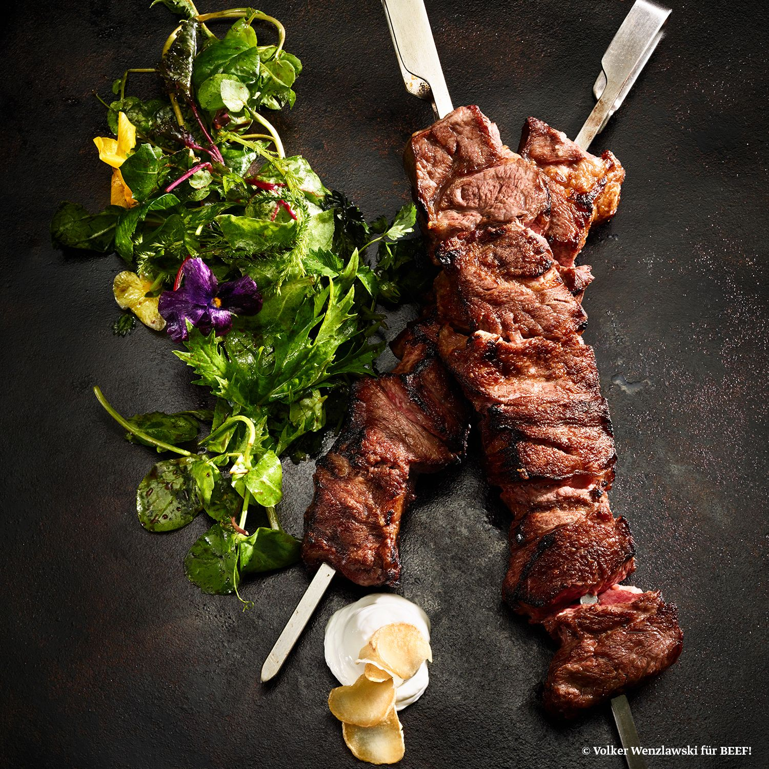 Photo of Western steak grill skewers with aioli and wild herb salad