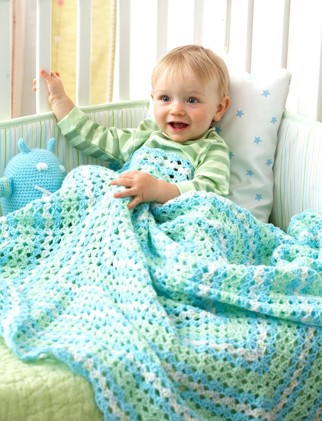 Yarnspirations bernat shell stitch blanket patterns lacy clustered blanket crocheted from the middle in soft shades of bernat big ball baby sport bankloansurffo Gallery