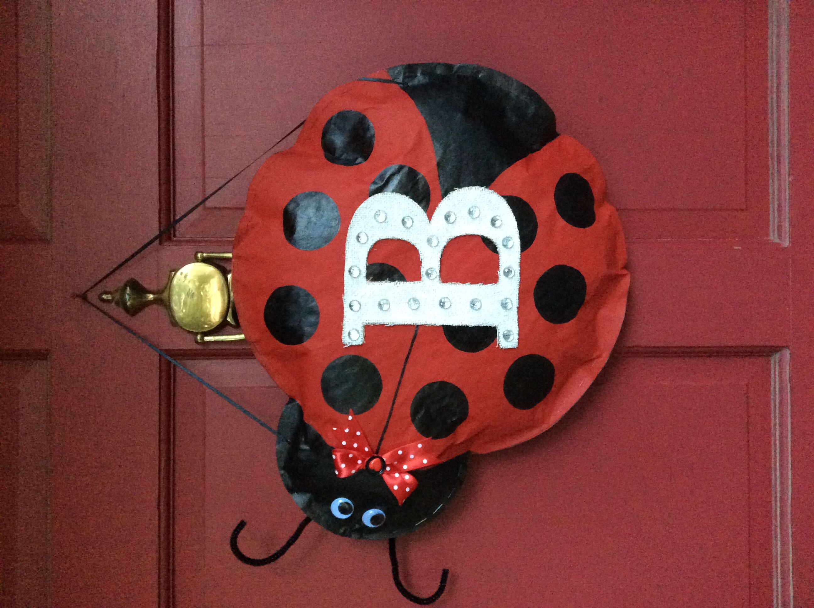 Ladybug Initialed Door Hanger Made From Brown Craft Paper Staple The Edges And Stuff With All Those Plastic Initial Door Hanger Door Hangers Ladybug