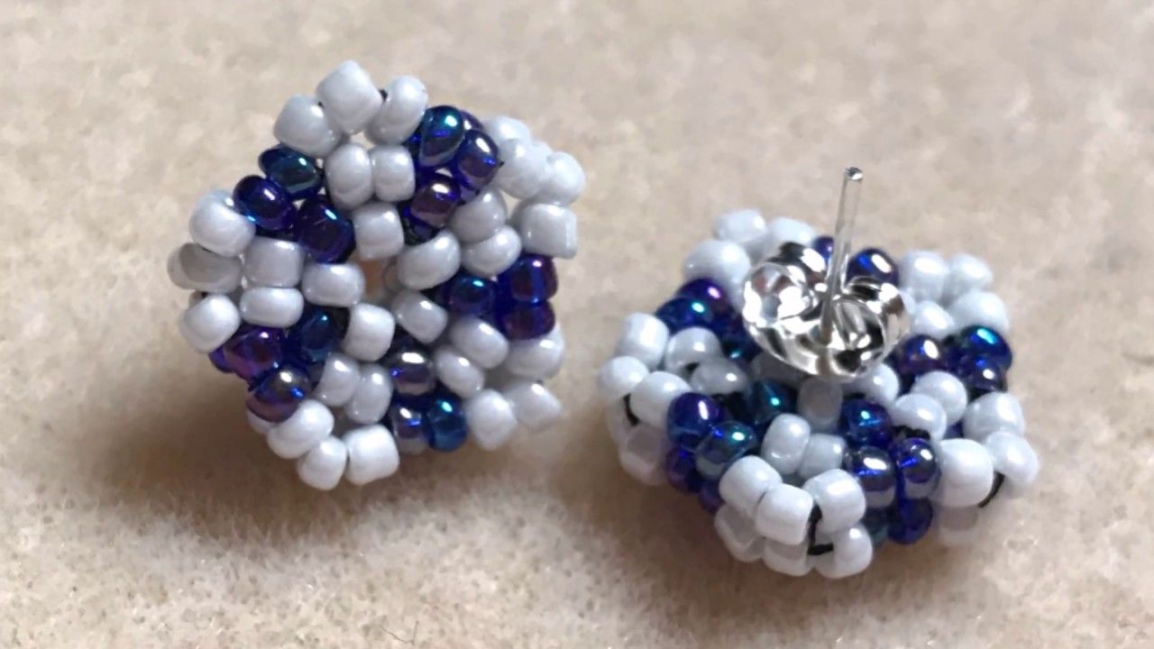 woman stud white and pin clothes bead earrings