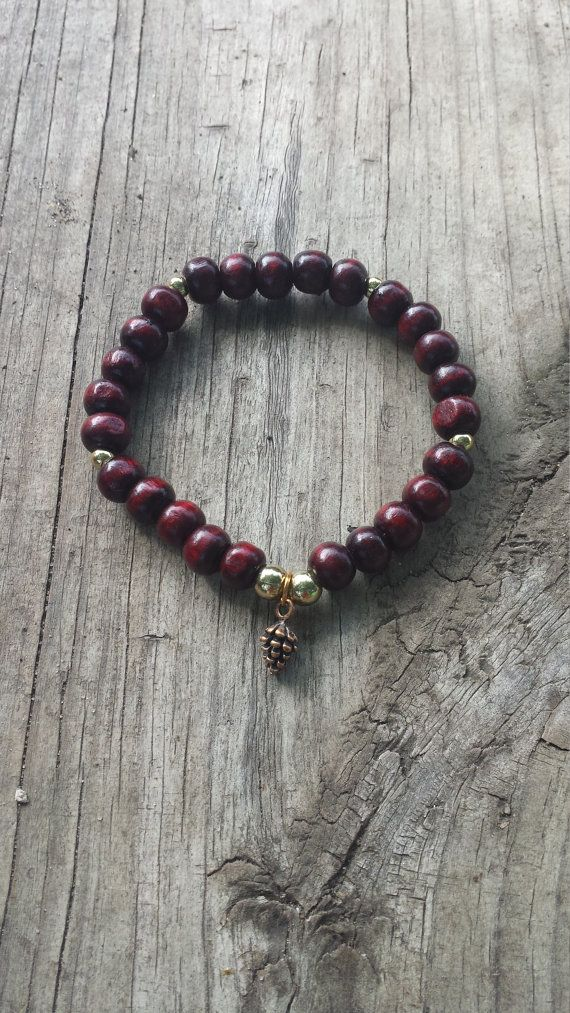 Check out this item in my Etsy shop https://www.etsy.com/listing/246939084/pine-cone-charm-wooden-mala-bead-stretch