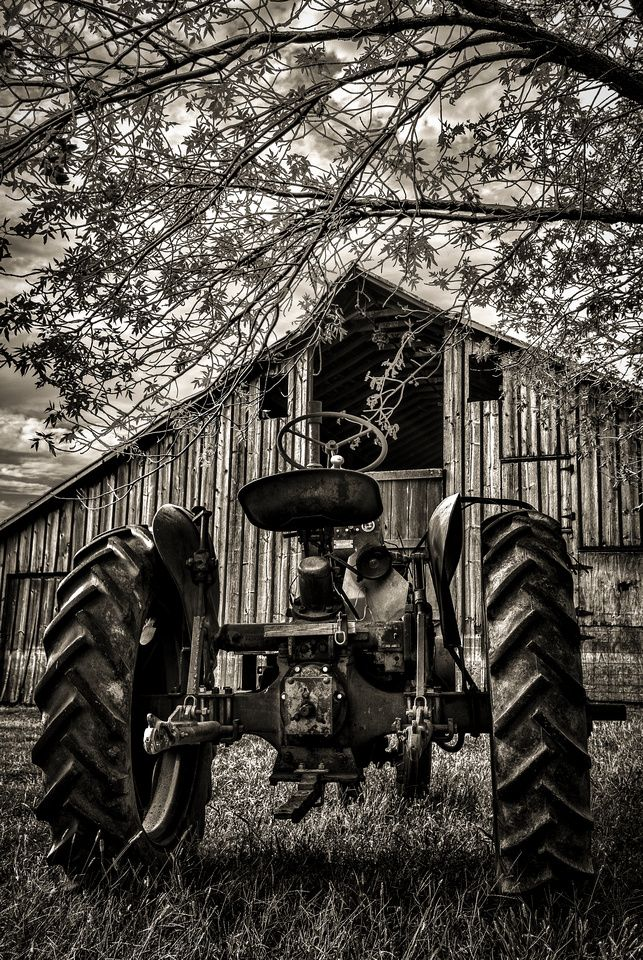 Old tractor and barn probably used years ago together as for Building a tractor barn