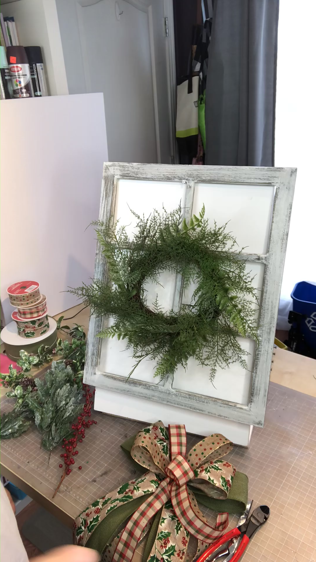 Christmas wreath made on a window frame for something unique this season!