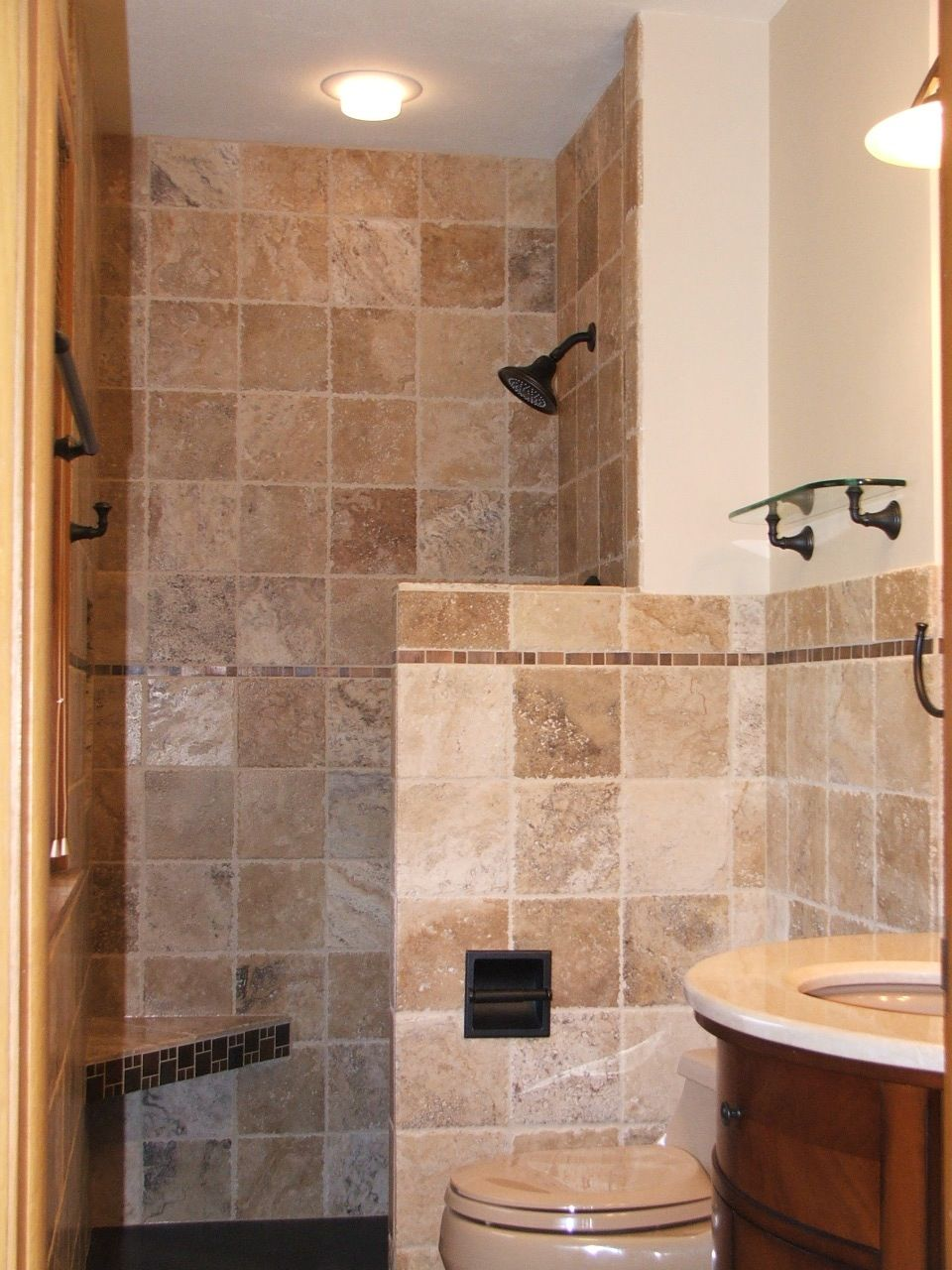 Tile is used artistically on the walls of this elegant bathroom ...