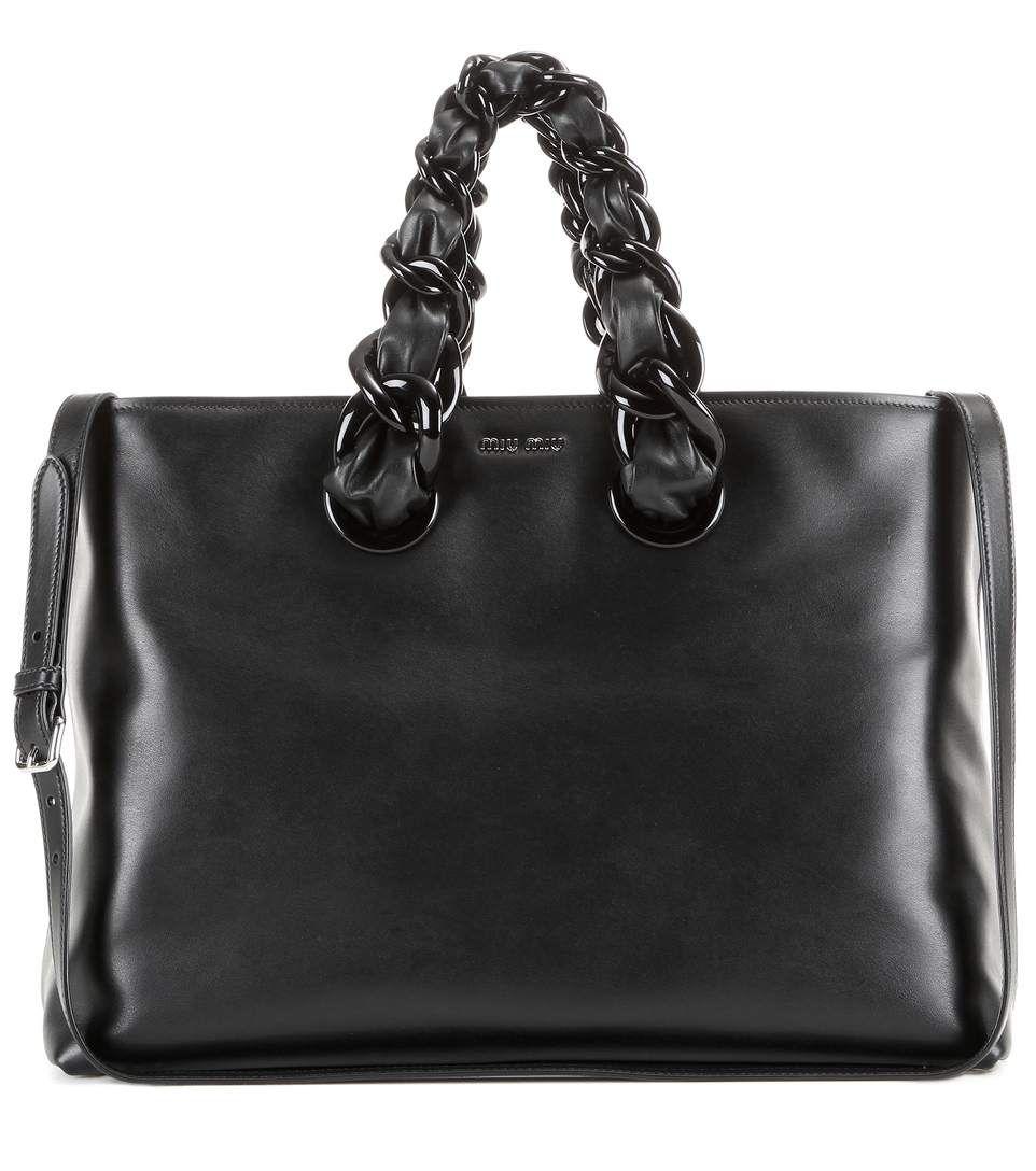 c485303d0cfc MIU MIU Leather Tote.  miumiu  bags  shoulder bags  hand bags  leather  tote   lining