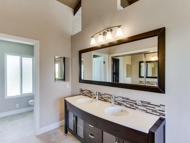 stand alone bathroom vanities. Master Suite With A Stand Alone Vanity Granite Countertop And Glass Tile Backsplash. 1405 Bathroom Vanities T