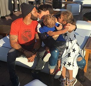 Omari Hardwick sharing an adorable family kiss with his wife and ...