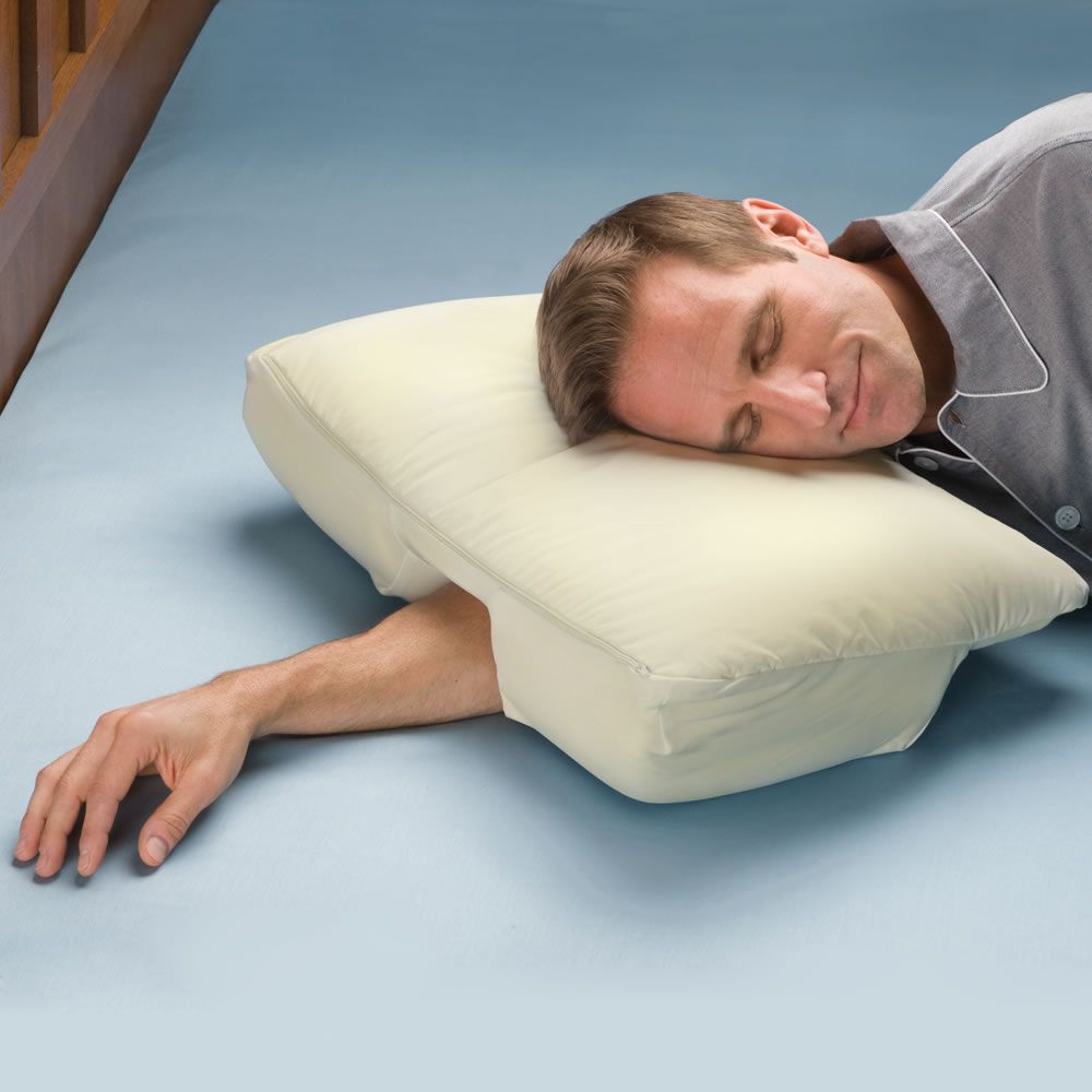 the arm sleeper s pillow hammacher schlemmer teachers the arm sleeper s pillow and a list of awesome things you didn t know you needed some are just lazy but there are gems in the mix