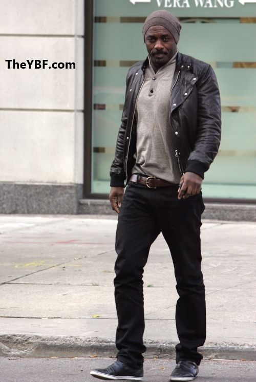 Leather jacket, grey shirt, brown belt, black pants, black shoes ...