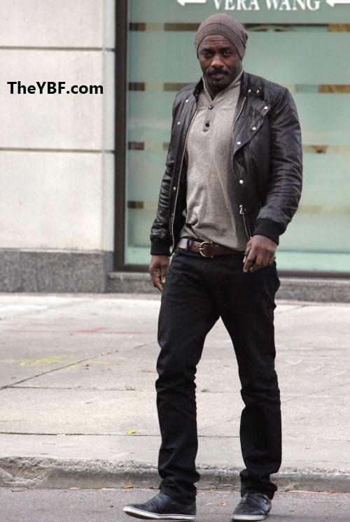 Leather jacket, grey shirt, brown belt, black pants, black shoes ...