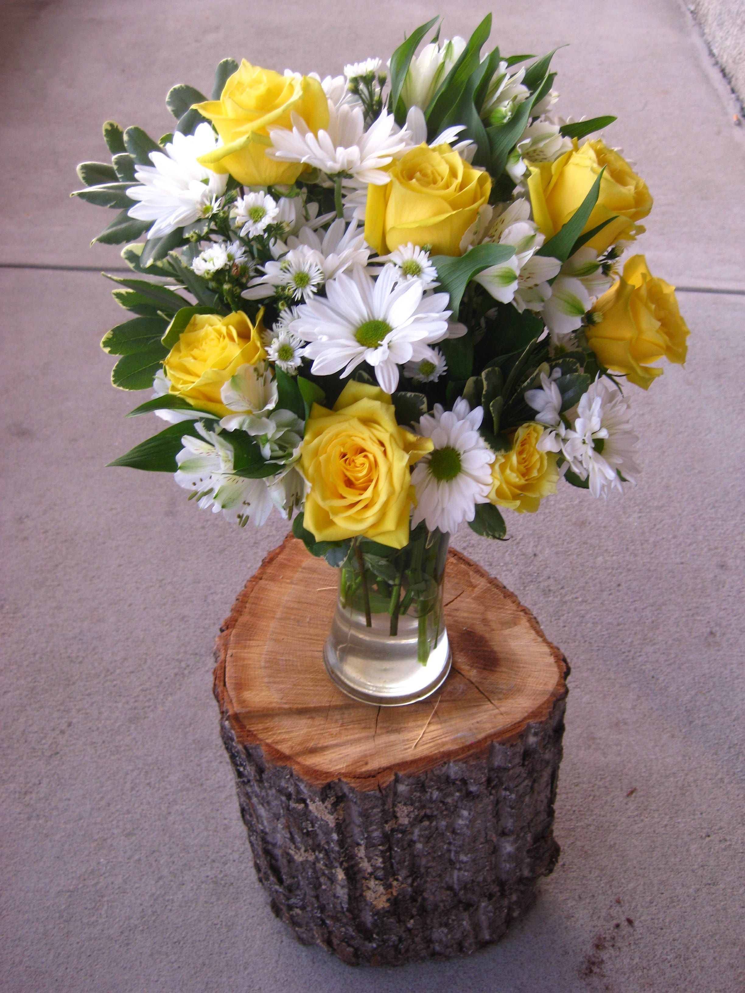 Spring is here white carnations yellow roses and i want coral find this pin and more on wedding flower ideas izmirmasajfo