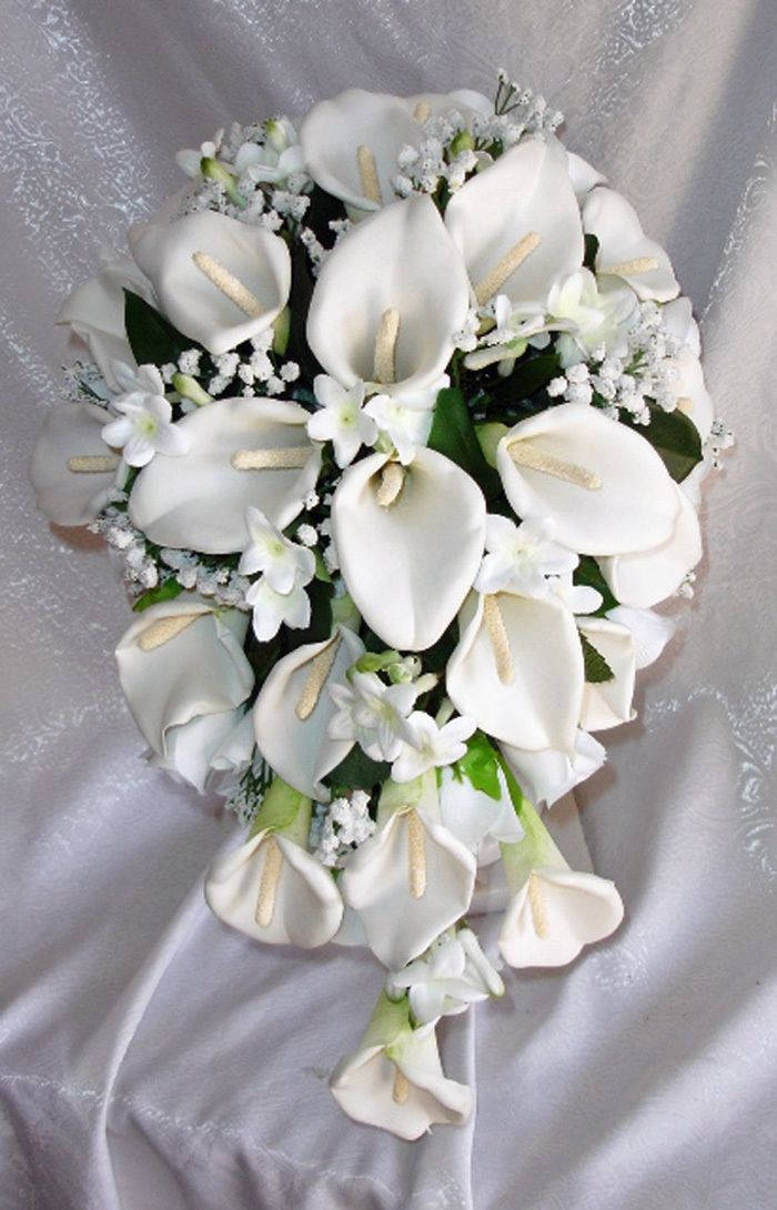 white and blue cascading bridal bouquet orchids peonies