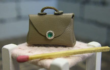 Handmade miniature handbag. Taupe coloured leather with a tiny green diamante trim.