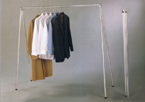 """Portable Packing Rack.  Perfect for organizing your closet, airing out clothes, packing for a trip or creating extra storage space in rooms with limited closets. Weighing just six pounds, it folds and opens in seconds and easily holds up to 60 outfits. It is 58"""" long by 58"""" high when set up and folds down easily to just 4' for quick storage.  No assembly is required."""
