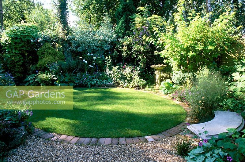 Shady Garden With Circular Lawn Mixed Planting And 400 x 300