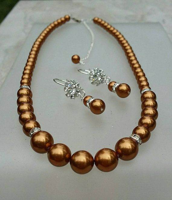 Check out this item in my Etsy shop https://www.etsy.com/listing/65240711/swaorvski-copper-pearl-set