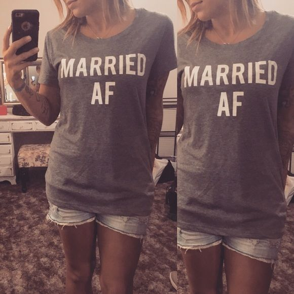 Married AF tee ❤️ Grey women's Married AF tee. Soft fitted material. The sizing is VERY small so if you're a medium or large I would definitely get this XL. The first picture looks blue but it is grey in color. I'm going to repeat again, it says size XL but it is a SMALL OR MEDIUM! look at 2nd photo for most accurate color ❤️❤️❤️ DailyTay Tops Tees - Short Sleeve