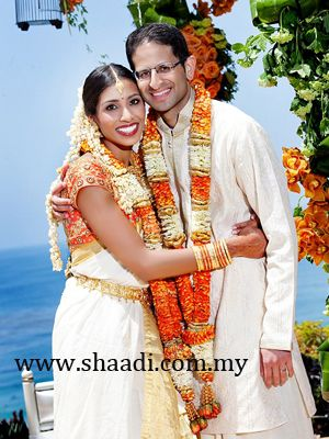 White and Orange Garland for White Dress Code.The traditional white ...
