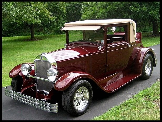 1928 Buick Master. This beautiful Street Rod in a dark garnett glass paint comes…
