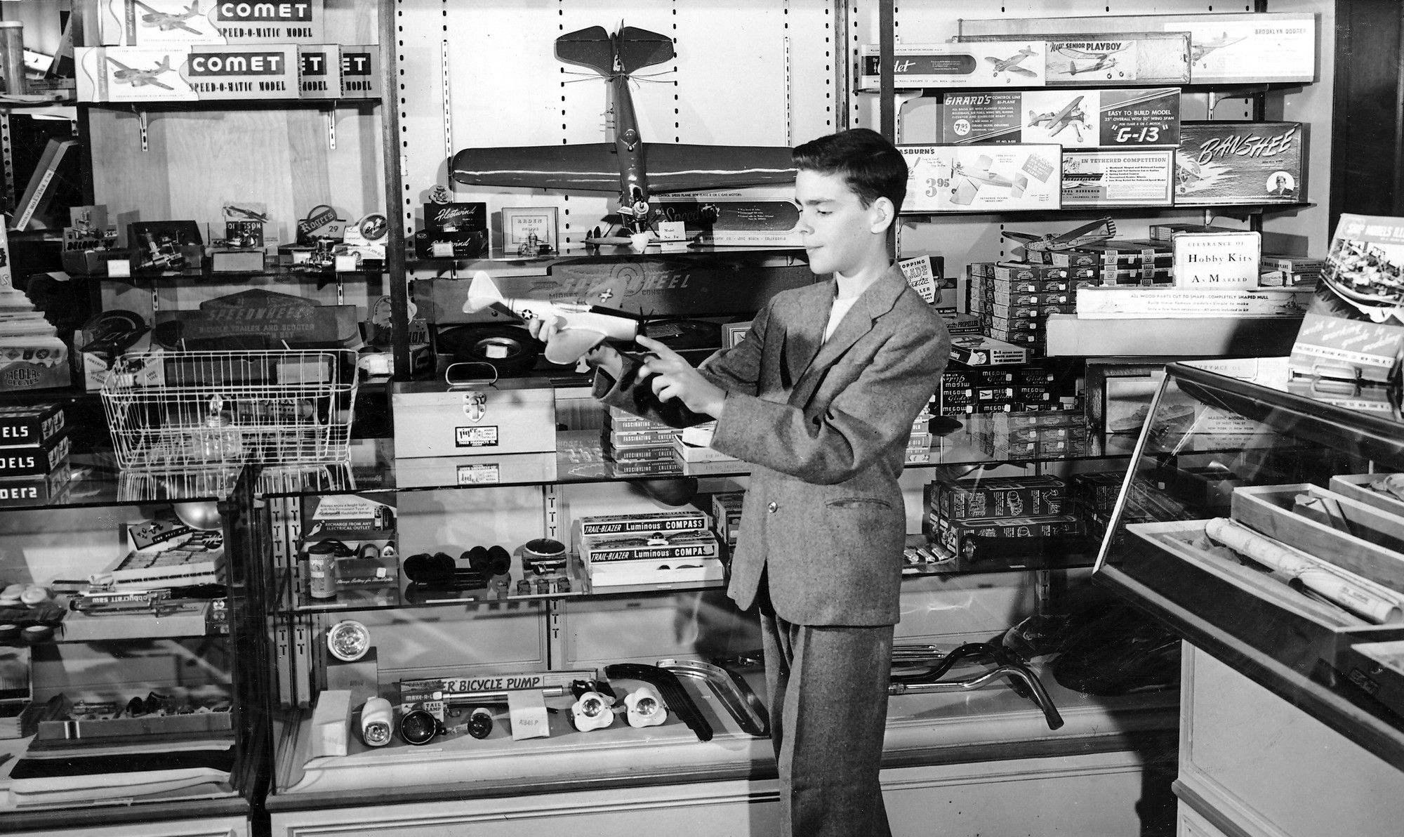 Boy with model plane in Lazarus toy dept. circa 1950