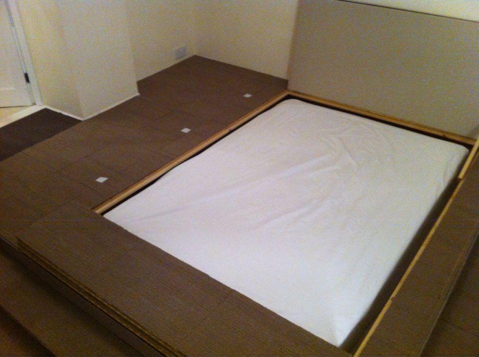 Bed hidden in raised flooring. Plus storage in floor and ...