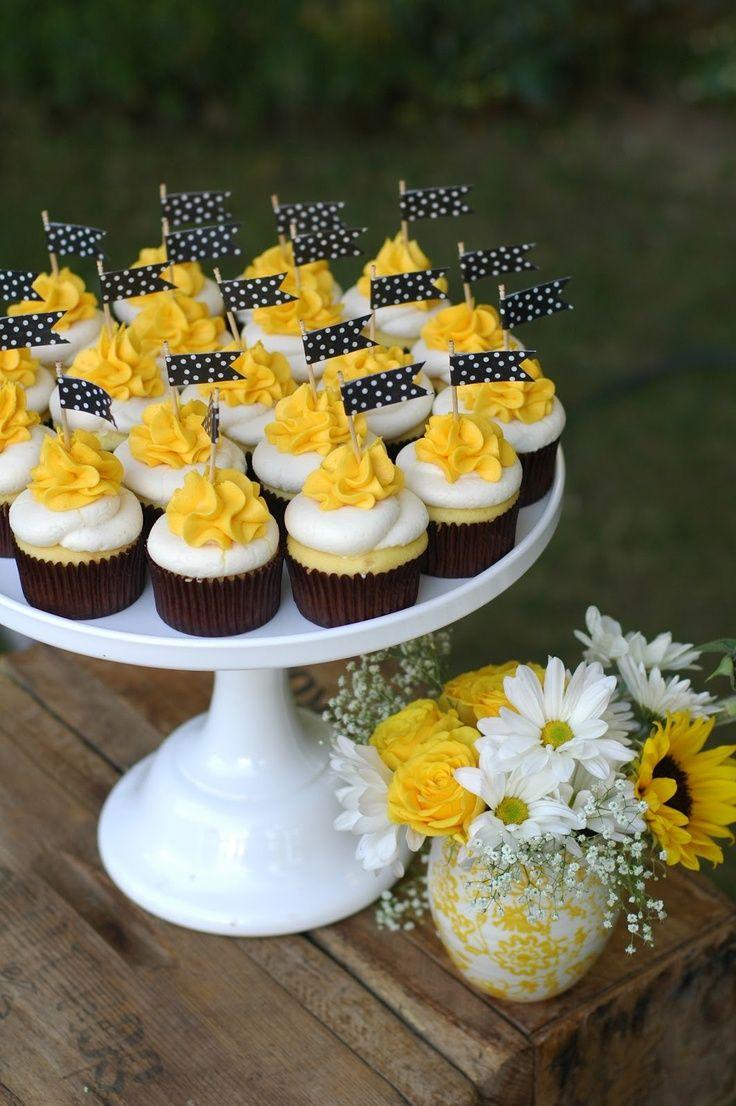 wedding cupcake ideas yellow wedding cupcakes with flag topper