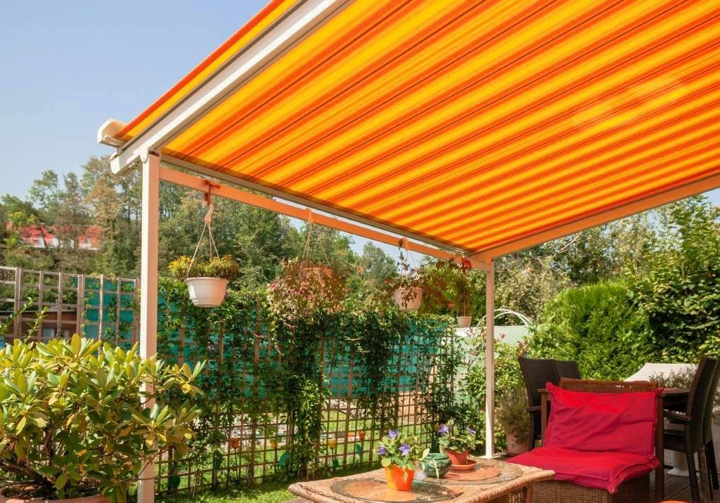 A Retractable Awning Provides A Great Escape In This Bright Back Yard Awning Retractable Awning Fabric Awning