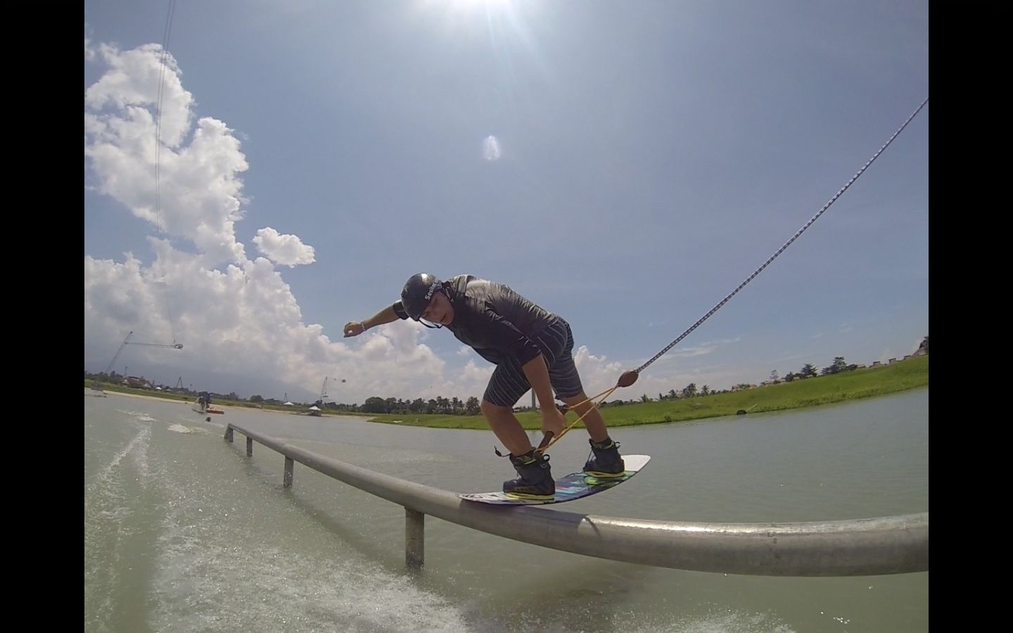 Wakeboarding. Metal pipe wakeboard hit by James Windsor at Camsur Watersports Complex, Philippines