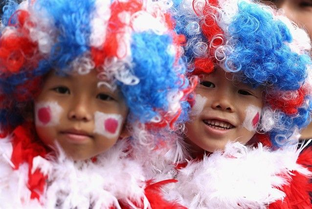 Passionate Olympic Fans - Slideshows | Japan fans show their support during the Women's Football first round Group F Match.   (Photo: Quinn Rooney / Getty Images) #NBCOlympics