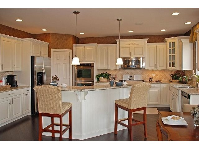 white cabinets with medium hardwoods