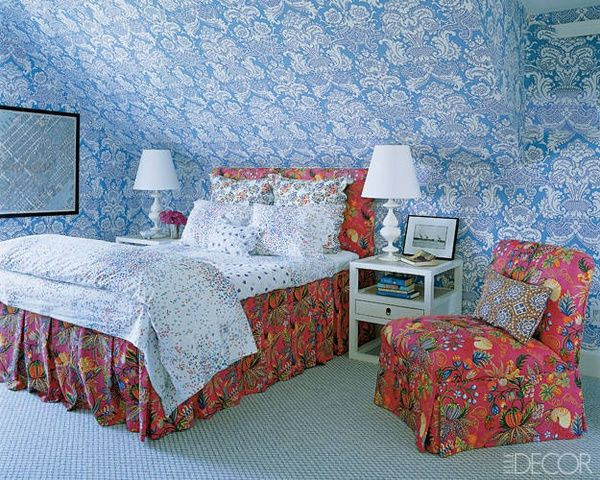 Love the mixed prints by Quadrille (both walls and chair/bed) and D. Porthault bed linens - cheery for an attic bedroom space - Veronica Beard's Hamptons home, decorated by Chiqui and Nena Woolworth, photo by Simon Upton