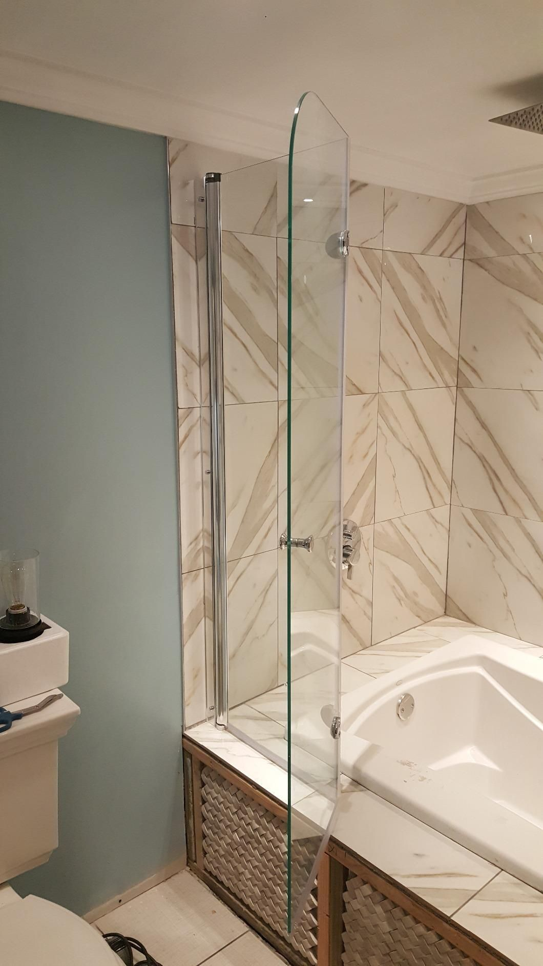Unique Folding 1 4 Inch Thick Glass Frameless Tub Door With Trackless System Aqua Fold Boasts An Out Of Plu Shower Doors Frameless Shower Doors Bathtub Doors