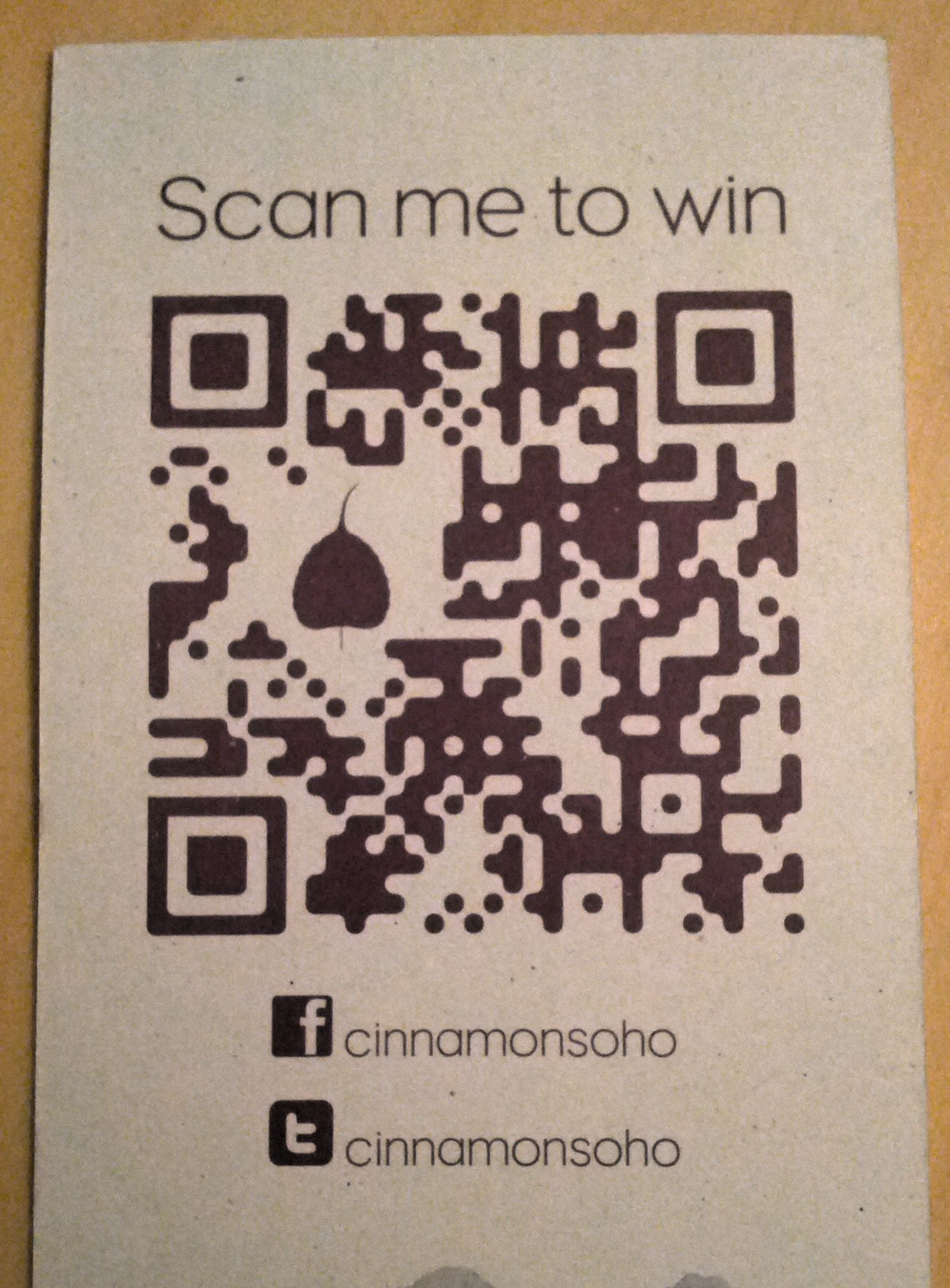 qr code on the back of a business card for cinnamon soho