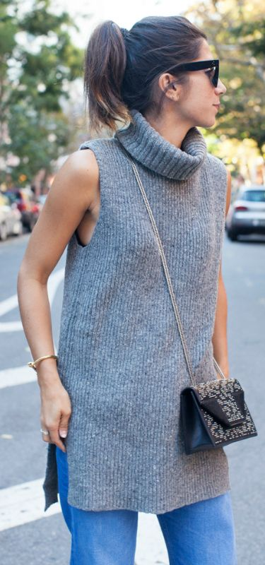 02ade8530bf58d A thick knitted sleeveless turtleneck will look great worn with simple  denim jeans and a cross body mini bag. Via Krystal Bick.