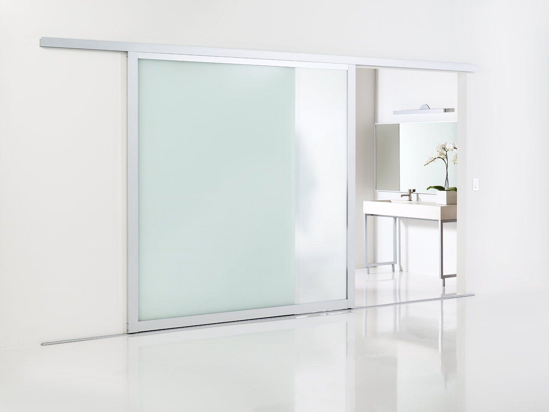 Large wall-slide doors installed as an elegant bathroom door ...