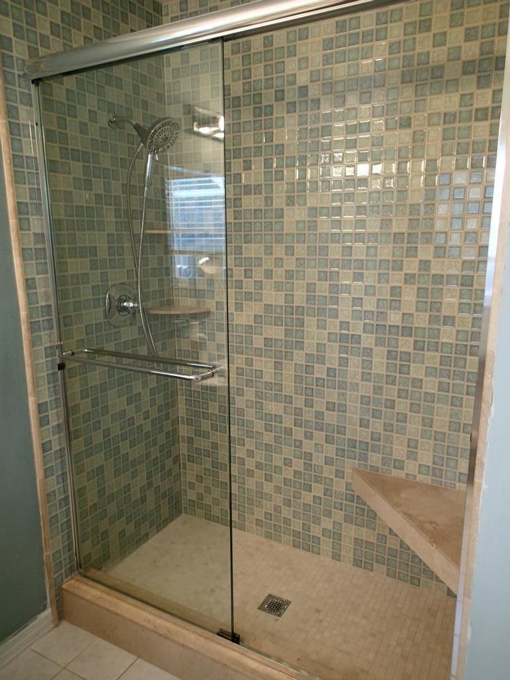Tub To Shower Conversion With Glass Tile Travertine Seat Shampoo Shelves And Shower Curb The Frameless 1 4 Glass With Images Tub To Shower Conversion Shower Conversion