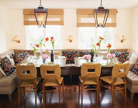 dining rooms - tufted dining bench bamboo blinds black lanterns woven dining chairs sconces  Bamboo roman shades, black iron lanterns, tufted