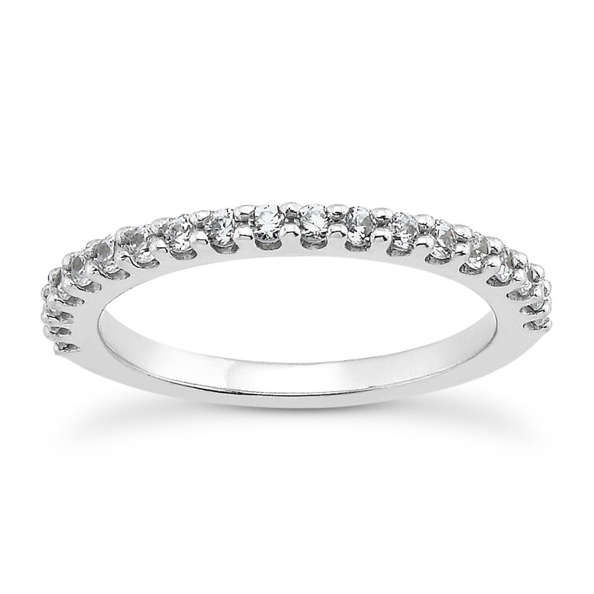 4f520e69a01 The slender profile of this sparkling shared prong wedding ring brings  understated elegance to the unique