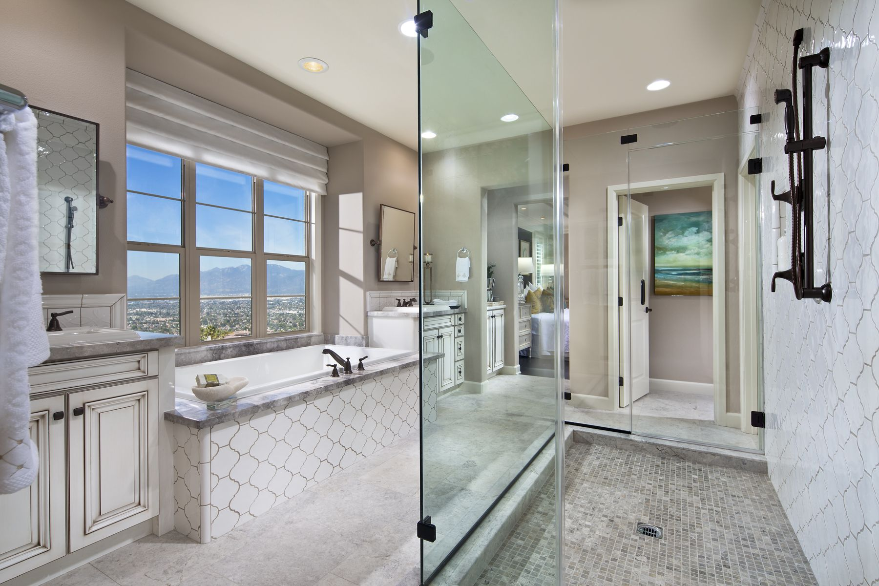 Sophisticated master bathroom decorated in all white features a