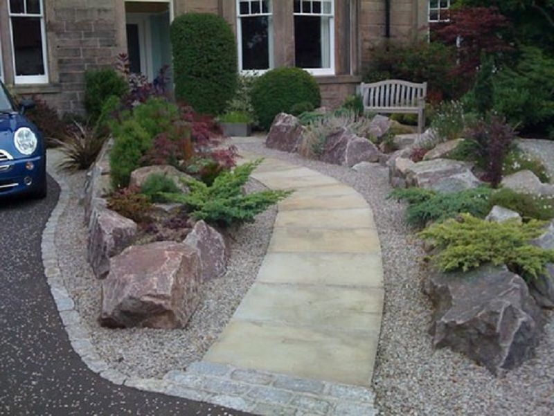 Simple rock garden with decorative flower bed driveway for Decorative landscaping rocks