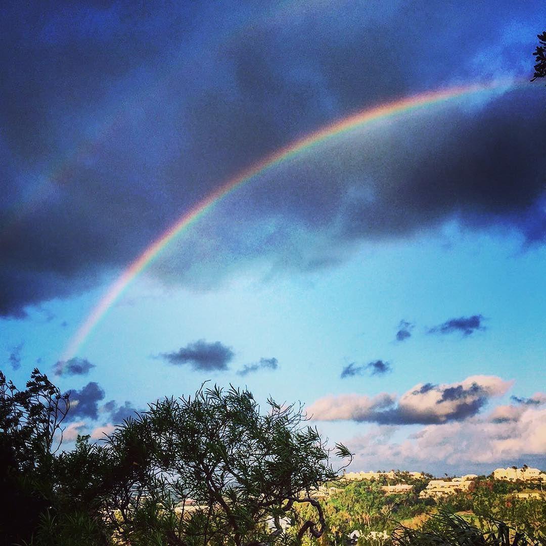 Dark clouds and rainbows #bda #ahhbermuda #rainbow #cloudsporn #scenery #whiteroofs #beautiful #islandlife #doublerainbow #wearebda by catchtheblueeye