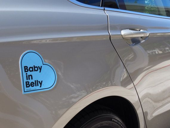 A Baby in Belly Car Magnet