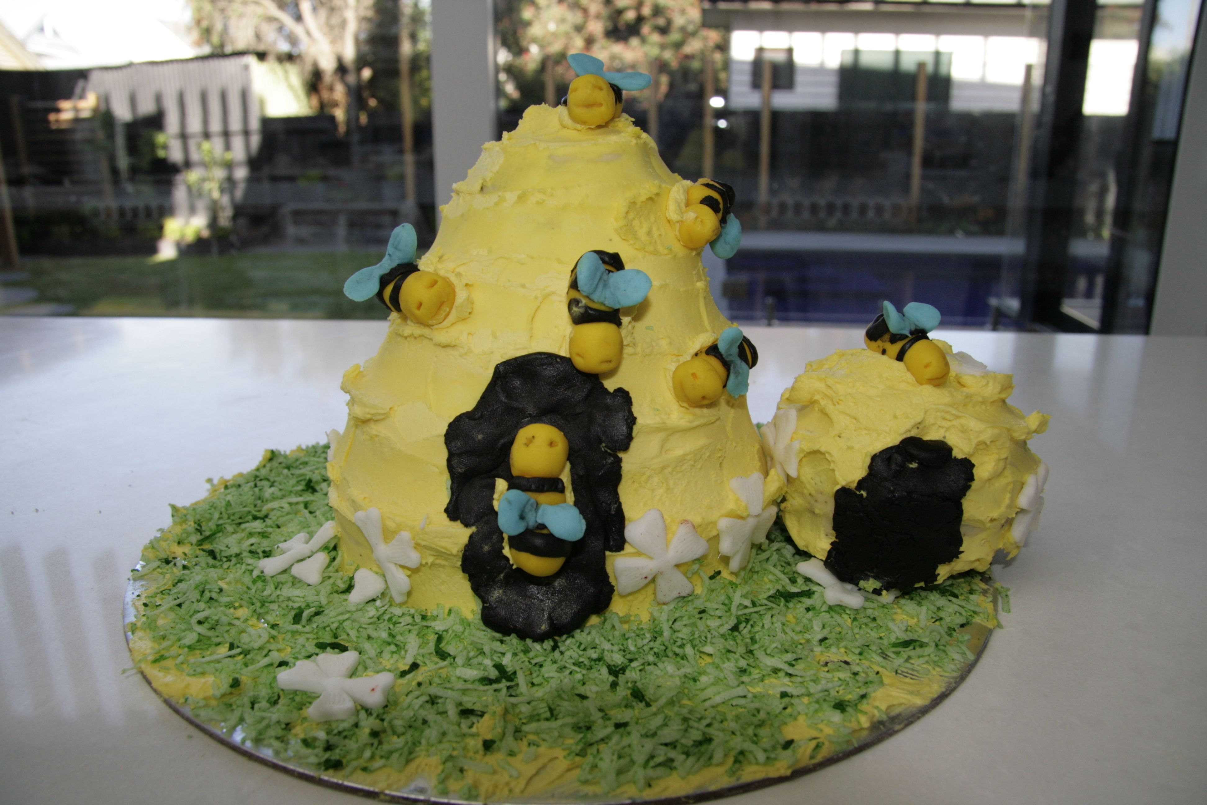 bee hive cake created by my 7 1/2 year old son, buttercream icing and fondant bees
