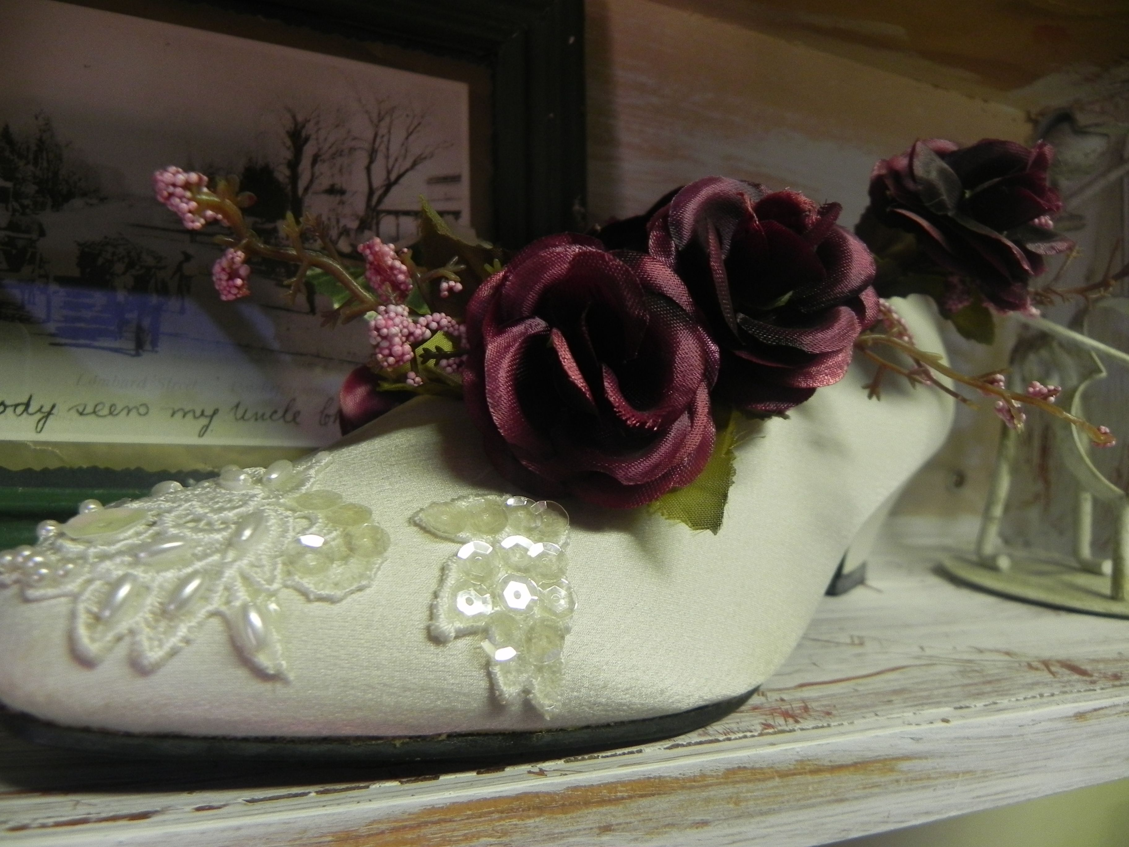 Use wedding shoe after wedding to display flowers